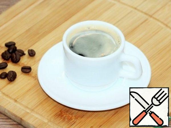 To make some coffee. I brewed 180 ml of coffee in an electric coffee maker. Strength of coffee to your taste. The stronger the cake, the more delicious and flavorful it is.
