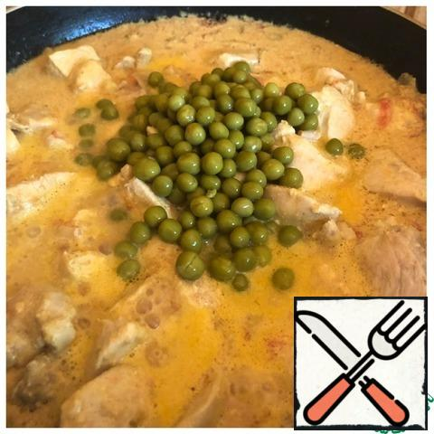 Add the peas and leave to simmer for another 5 minutes. Serve the chicken with fresh herbs.