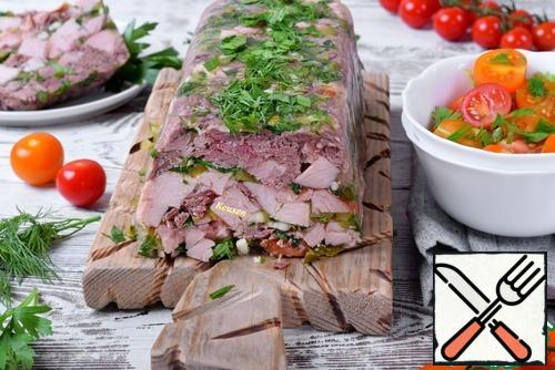 Serve the meat terrine, topping it with a salad of fresh vegetables.