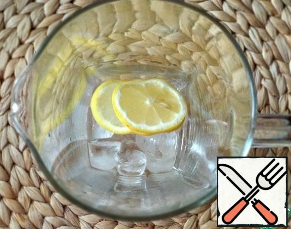 Before serving, put ice (optional) and sliced lemon in the carafe, and strain the tea through a strainer.