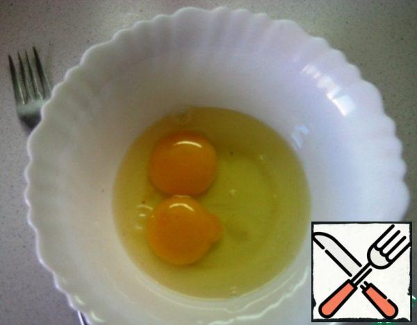 In a separate bowl, beat the eggs with a fork.