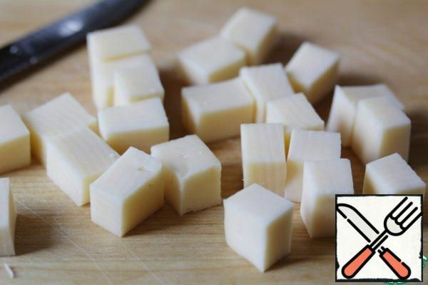 Cut the cheese into cubes.