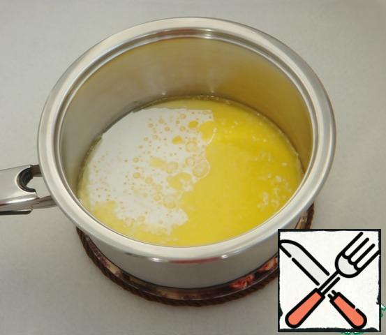 Pour in the cream, mix and cook over medium heat until it boils.
