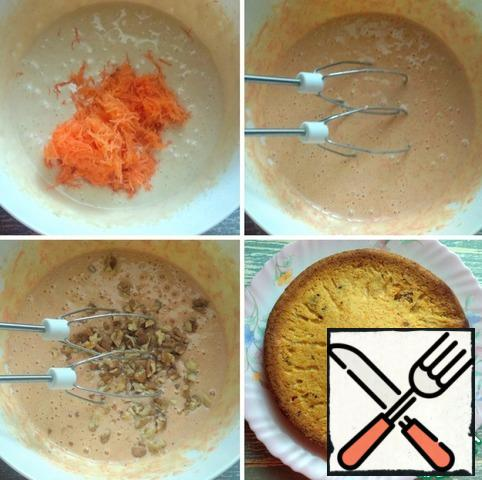 Next, grate the carrots on a fine grater, mix. Then add the chopped walnuts, mix again. Transfer the dough to a detachable baking dish (diameter 20 cm), cover the bottom with foil or parchment. Cook in the oven, preheated to 170 degrees, 30-35 minutes. Remove the mold from the oven, let stand for 10-15 minutes, then remove from the mold. Check readiness with a wooden skewer.