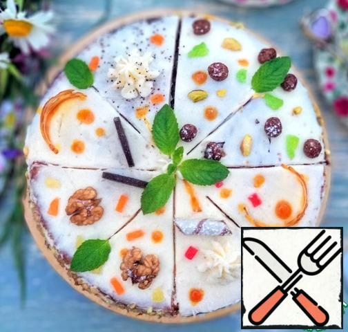 Decorate as desired. Boca poppy pieces I sprinkled with poppy, Boca chocolate pieces - chopped pistachios, sides of carrot slices - chopped walnuts, sides coconut-pineapple slices - coconut. Then put it in the refrigerator for at least 2 hours. Before serving, I decorated the cake with caramel, poppy seeds, chocolate balls, nuts, chocolate, waffle tube, candied fruit and mint leaves.