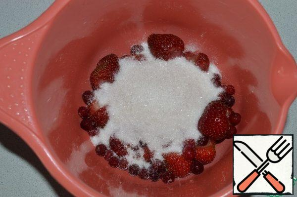 Combine the strawberries, cranberries and sugar. Chop with a blender.