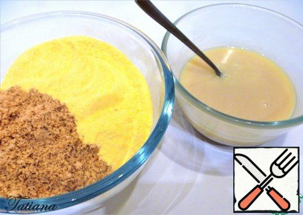 Chop the cornflakes and almonds (separately) and mix with the melted chocolate.