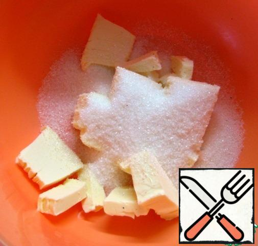 In a bowl, combine the pieces of butter, sugar and a pinch of salt.