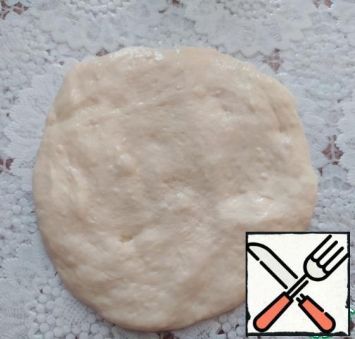 Knead each part of the dough with your hands into a flat cake.