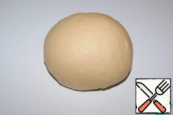Roll the dough into a ball and place in a warm place for 40 minutes.