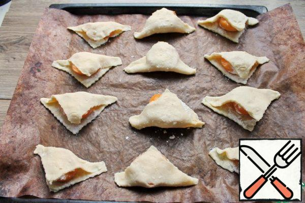Put in a hot oven and bake for 15 to 18 minutes, until the edges of the dough are lightly browned. The dough is low in sugar, so do not expect a strong blush on them.