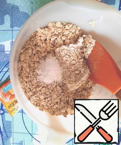 Mix oat flakes, salt and baking powder.