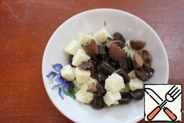 Milk, dark and white chocolate (each take 30 g) cut into pieces.