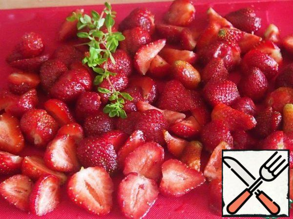 Wash the berries and cut them into halves.