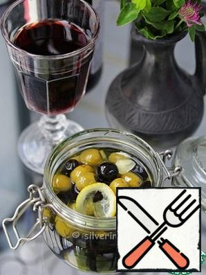 Pour all the olive oil and close the jar (not hermetically). Leave at room temperature for 1 day, then put in the refrigerator for 5-6 days.Olives become noticeably tastier-tested! And you still have a delicious aromatic oil that can be added to salads and other dishes.Bon Appetit!