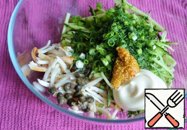 Chop the greens into a salad bowl. Season with mayonnaise and mustard.