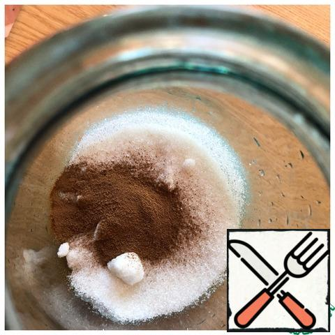 Put coffee and sugar in a 3-liter jar.