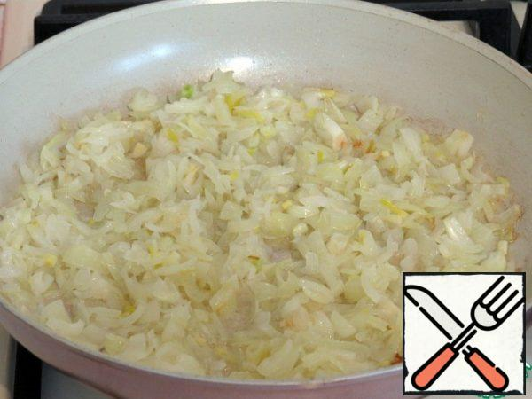 Finely chop the onion and fry in vegetable oil until Golden.