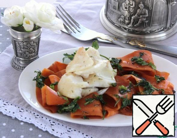 Put the carrots on a plate, put the fish on top, pour the butter and herbs.