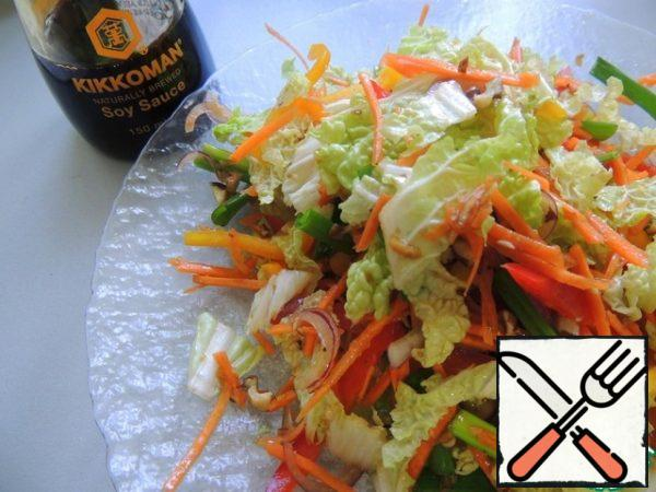 Combine all the vegetables, add the onion cut into half rings, crushed nuts. Fill with the dressing and mix gently, preferably with your hands, so as not to damage the vegetable straws.