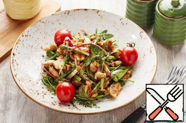 On a serving plate, put the mix with vegetables, top-fried vegetables with fillets and pour the resulting sauce. Decorate the finished dish with pea sprouts and pour a small amount of balsamic cream.