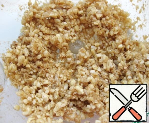 Combine vinegar, salt, pepper, chopped walnuts and garlic.