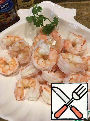 Boil the peeled prawns in salted water until tender and chill immediately.