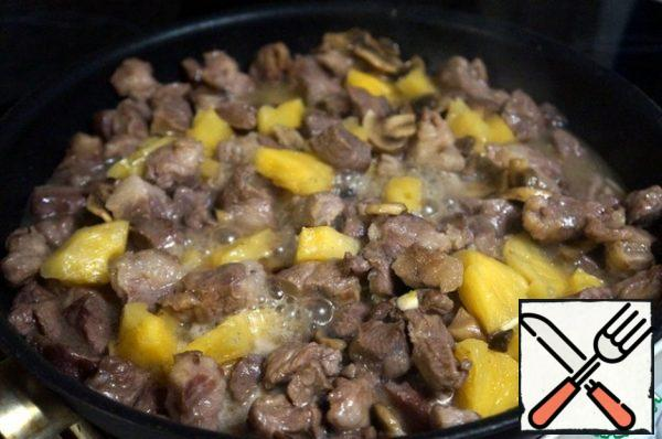 Add the pineapple along with the juice and garlic. Add salt, pepper, mix, and simmer without lid on medium heat for five minutes.