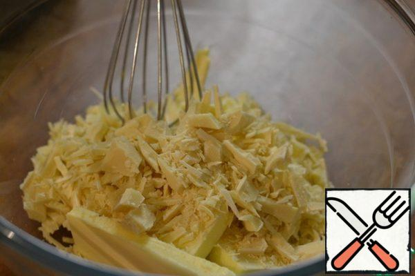 Melt the white chocolate and 100g of butter in a water bath, stirring constantly. Leave to cool.