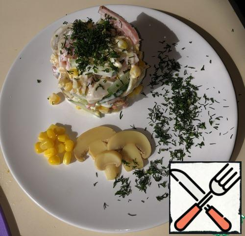 Season the salad with mayonnaise and mix well. If desired, you can serve it on the table with herbs.