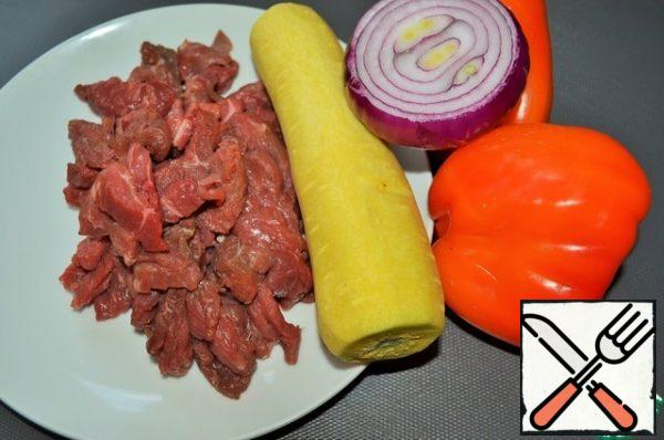 Prepare food, wash and clean vegetables Cut the meat into thin bars.