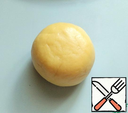 Combine the butter and flour mixture with the egg and knead the dough.