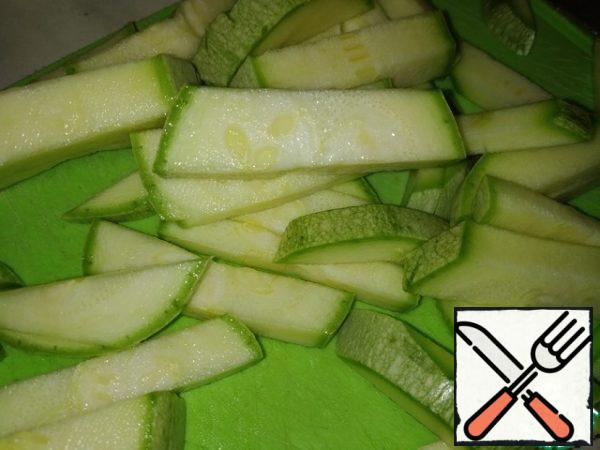 Cut zucchini into strips.