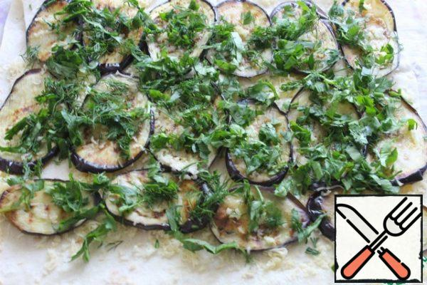 On eggplant chopped greens.