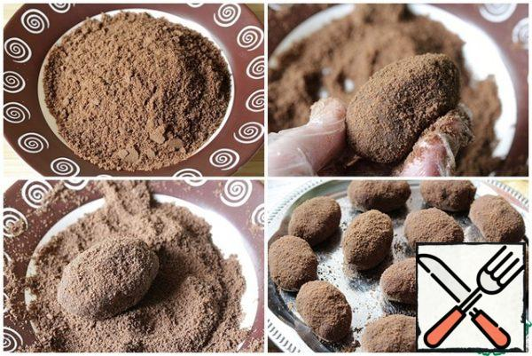 Form cakes and roll them in crushed chocolate cookies or cocoa powder. Put it in the refrigerator overnight.