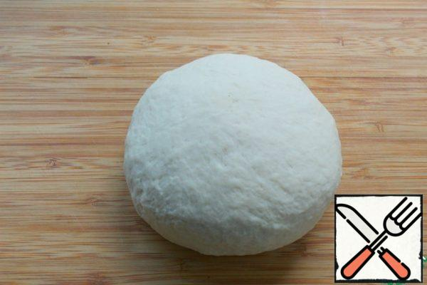 Knead the soft dough, cover and leave in the heat for 30 minutes.