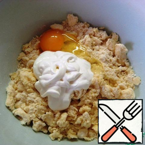 Add the egg and sour cream.