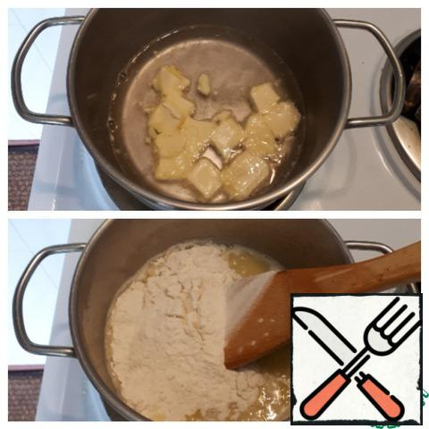 Prepare the custard dough. In a saucepan, bring the water and margarine to a boil, add salt. Pour the flour into the boiling mixture and brew the dough.