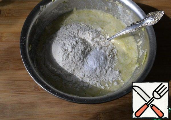 Add the flour with baking powder and mix.