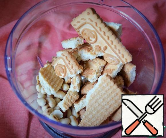 Cookies and peanuts are crushed into crumbs.