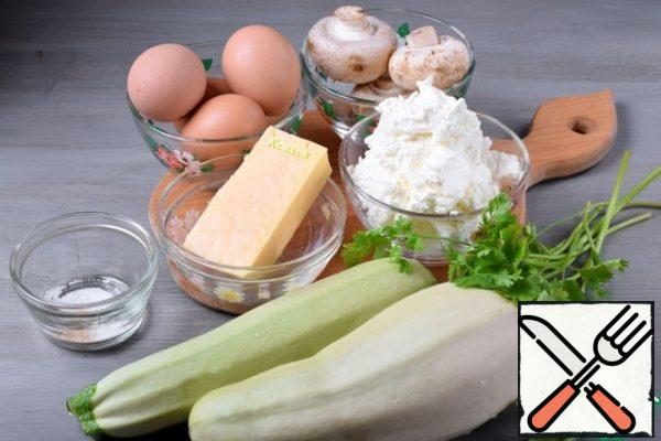 Prepare the products. Will need two young zucchini, preferably one vegetable with a small diameter. Let's take the cheese that is in the refrigerator. Greens - to taste. For a more piquant taste, you can add a clove of garlic to the filling.