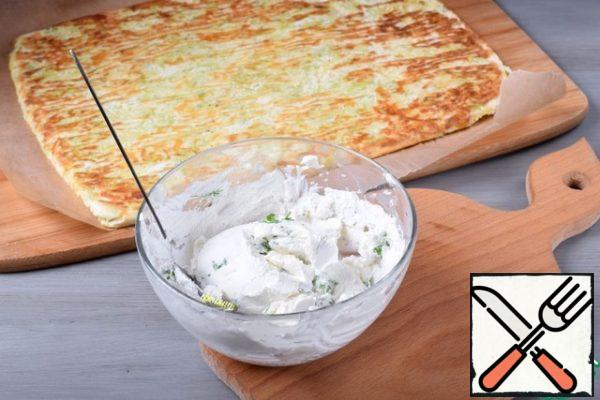 Bake the base for about 20 minutes or until fully cooked. Cool the resulting layer in the form a little, and then tip it over on a clean parchment so that the pattern is at the bottom. For the filling, mix cottage cheese, chopped herbs, salt and spices.