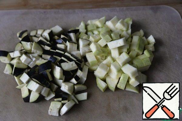 Young zucchini and eggplant cut into cubes. If you are afraid that the eggplant will be bitter, then cut off the skin.
