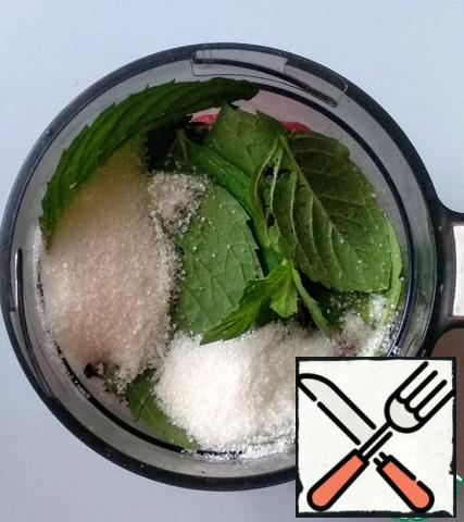Add the washed mint leaves and sugar.