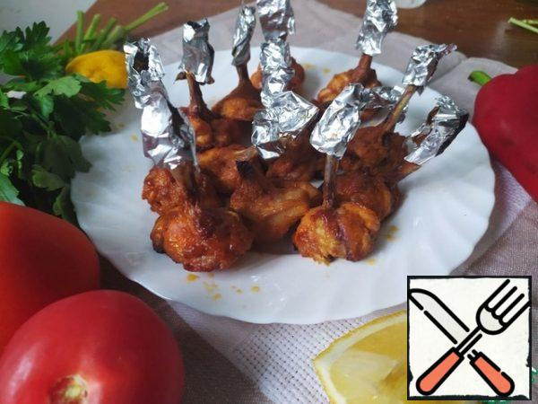 Bake the wings in a preheated 200-degree oven until they are nicely browned.