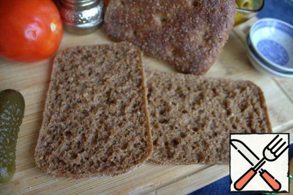 I love the combination of cheese with this pure rye coarse bread. Loaves are sold already cut lengthwise.
