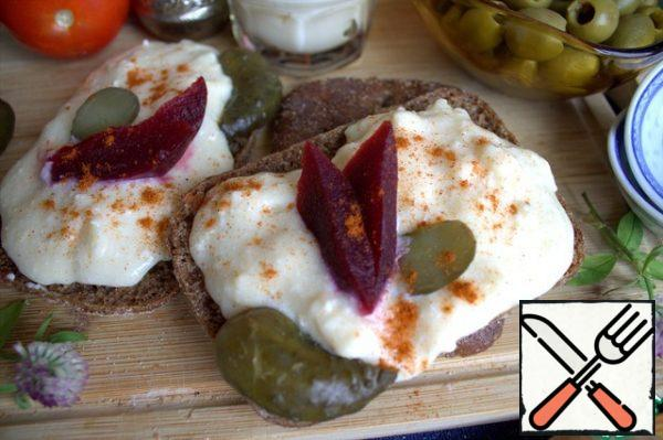 And a pickle. In the cheese itself or on top, you can add paprika and a little chili pepper.