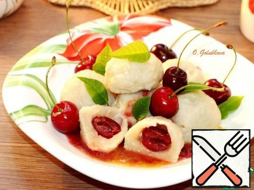 Remove the finished dumplings with a slotted spoon and serve immediately with the chilled sauce.Bon Appetit!