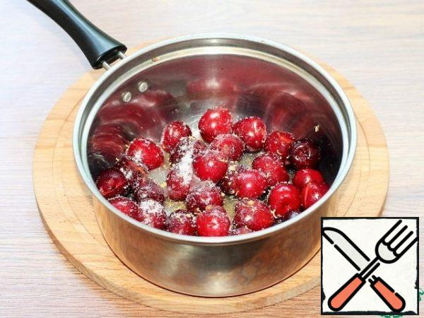 Mix the berries with the sugar, zest and water. Stir. Bring the mixture to a boil over a low heat.