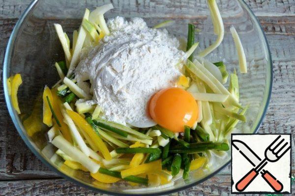 Add flour and starch, yolk.